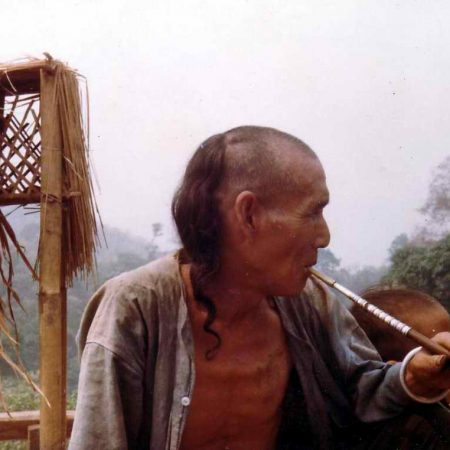 Akha_man_with_opium_pipe